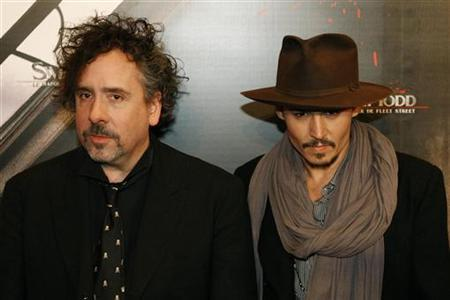 Tim Burton (L) and Johnny Depp pose for photographers at the premiere of the film ''Sweeney Todd: The Demon Barber Of Fleet Street'' in Paris January 16, 2008. REUTERS/Benoit Tessier