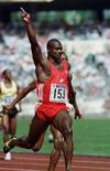 <p>Ben Johnson celebrates after setting a new world record in the 100 meter race with a time of 9.79 seconds at the 1988 Olympics in Seoul, September 24, 1988. REUTERS/Stringer</p>