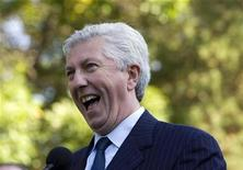 <p>Bloc Quebecois leader Gilles Duceppe laughs as he speaks to media during a campaign stop in Montreal, September 22, 2008. REUTERS/Christinne Muschi</p>