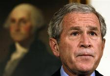 """<p>Standing in front of a painting of George Washington, President George W. Bush speaks about the economic rescue plan at the White House in Washington September 30, 2008. Bush said on Tuesday the U.S. economy was depending on decisive action from the government on a financial bailout plan or the economic damage could be """"painful and lasting"""". REUTERS/Kevin Lamarque</p>"""