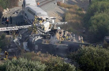 Firefighter work to rescue victims after a Metrolink commuter train en route from Los Angeles' Union Station to Oxnard collided with a freight train in the Chatsworth area, September 12, 2008. REUTERS/Gus Ruelas