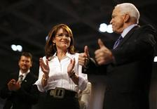 <p>Republican presidential nominee Senator John McCain, Republican vice presidential nominee Alaska Governor Sarah Palin (C) and her husband Todd (L) greet supporters during a rally in Virginia Beach, Virginia October 13, 2008. REUTERS/Carlos Barria</p>