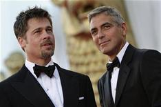 """<p>U.S. actors Brad Pitt (L) and George Clooney pose on the red carpet at the Film Festival in Venice August 27, 2008. Pitt and Clooney star in Ethan and Joel Coen's movie """"Burn After Reading"""" which is opening this year's Venice Film Festival. REUTERS/Max Rossi</p>"""