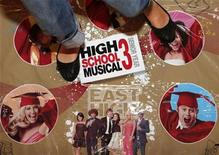 """<p>A girl poses with the """"High School Musical 3 Got the Moves Dance Mat"""" toy at the Dream Toys exhibition in London October 15, 2008. REUTERS/Stephen Hird</p>"""