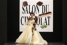 <p>French TV host Anne-Gaelle Riccio presents a creation by Ozlem Suer and Bonnat Chocolatier at the 14th Salon du Chocolat (Paris Chocolate Show) in Paris, October 28, 2008. REUTERS/Benoit Tessier</p>