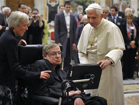 Pope Benedict XVI (R) greets British professor Stephen Hawking during a meeting of science academics at the Vatican October 31, 2008. REUTERS/Osservatore Romano