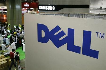 Shoppers walk past a Dell booth at the COMEX information technology and consumers technology exhibition in Singapore in this August 28, 2008 file photo. REUTERS/Tim Chong