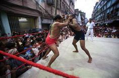 <p>Un match di wrestling amatoriale in India, nell'ottobre del 2008. REUTERS/Jayanta Shaw</p>