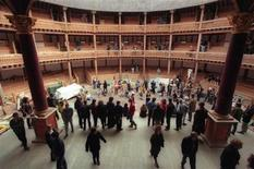 <p>Cast members of the Globe Theater company pose for photographers on the completed stage at the reconstruction of Shakespeare's Globe Theatre in London, May 22, 1997. REUTERS/Russell Boyce</p>