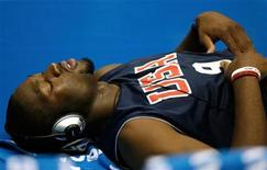<p>U.S. guard Dwyane Wade lies on the floor listening to music during practice for the world basketball championships in Sapporo August 17, 2006. REUTERS/Lucy Nicholson</p>
