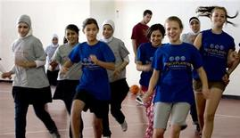 <p>Palestinian and Israeli girls run during a PeacePlayers International basketball practice in Jerusalem, November 6, 2008. REUTERS/Eliana Aponte</p>