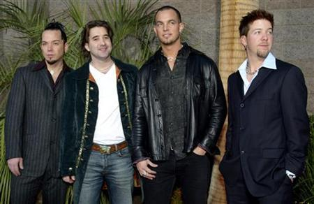 Members of the rock band Creed, from left, bassist Brett Hestla, singer Scott Stapp, guitarist Mark Tremonti and drummer Scott Phillips, arrive at the 2002 Billboard Music Awards show at the MGM Grand Garden Arena in Las Vegas, Nevada, December 9, 2002. Creed won four awards including Group/Duo of the Year. REUTERS/ Steve Marcus