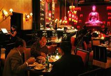 <p>People enjoy their dinner at Buddha Bar Restaurant in Jakarta December 4, 2008. REUTERS/Beawiharta</p>
