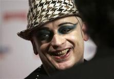 <p>Singer Boy George laughs during an interview after a fashion show for his label B-Rude in Madrid November 16, 2006. REUTERS/Andrea Comas</p>