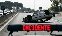 <p>A police car is parked next to a car accident site on Aurelia high road in northern Rome July 21, 2007. REUTERS/Max Rossi</p>