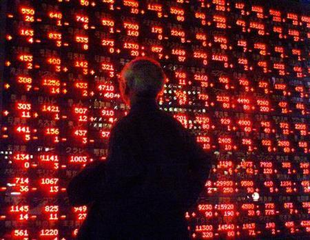 An elderly Japanese man looks at share prices displayed on a stock quotation board outside a Tokyo securities company November 8, 2000. REUTERS/Toshiyuki Aizawa