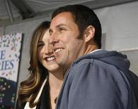 """<p>Adam Sandler poses with wife Jackie at the premiere of his news film """"Bedtime Stories"""" in Hollywood, California, December 18, 2008. REUTERS/Fred Prouser</p>"""