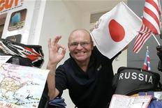 <p>Vladimir Yarets, 67, from Belarus poses with his motorbike in Singapore December 21, 2008. Yarets, who lost his hearing when he was an infant due to a Nazi bombing raid during World War II, is aiming to be listed in the Guinness Book of World Records as the first deaf person to travel around the world on a motorbike. REUTERS/Rina Ota</p>