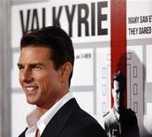 """<p>Cast member Tom Cruise poses at the premiere of the movie """"Valkyrie"""" at the Directors Guild of America in Los Angeles, December 18, 2008. REUTERS/Mario Anzuoni</p>"""