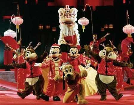 Disney's cartoon characters perform with lion dancers at Hong Kong Disneyland to celebrate Chinese Lunar New Year in this January 29, 2006 file photo. REUTERS/Paul Yeung