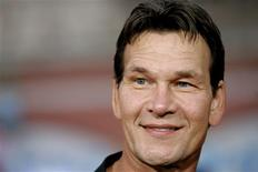 """<p>Actor Patrick Swayze attends the fan screening of """"Mission: Impossible III"""" at the Grauman's Chinese theatre in Hollywood in this May 4, 2006 file photo. In a television interview airing January 7, 2009, Swayze said he was scared, angry and """"going through hell"""" with pancreatic cancer, but a year after being diagnosed, he was determined to keep going. REUTERS/Mario Anzuoni/Files</p>"""