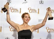 "<p>Actress Kate Winslet holds her awards for Best Actress in a Motion Picture Drama for ""Revolutionary Road"" and Best Supporting Actress in a Motion Picture for ""The Reader'' at the 66th annual Golden Globe awards in Beverly Hills, California January 11, 2009. REUTERS/Lucy Nicholson</p>"