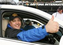 <p>Actor Kevin James gestures from the pace car at the start of the Pepsi 400 NASCAR Nextel Cup Series race at the Daytona International Speedway in Daytona Beach, Florida July 7, 2007. REUTERS/Mark Wallheiser</p>