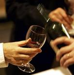 <p>A man tastes red wine in the Millesima cellar in Bordeaux, southwestern France, southwestern France, June 20, 2008. REUTERS/Regis Duvignau</p>