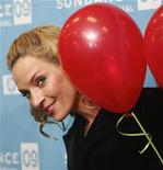 """<p>Actress Uma Thurman smiles as she peers around balloons that she brought to give out to the media as she arrives for the premiere of the film """"Motherhood"""" at the 2009 Sundance Film Festival in Park City, Utah January 21, 2009. REUTERS/Danny Moloshok</p>"""