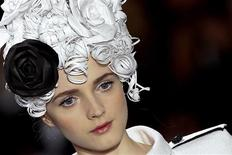 <p>A model presents a creation by German designer Karl Lagerfeld as part of his Spring-Summer Haute Couture 2009 fashion show for French fashion house Chanel in Paris January 27, 2009. REUTERS/Jacky Naegelen</p>