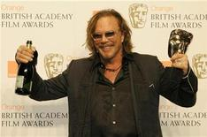 """<p>Mickey Rourke poses after winning the award for Leading Actor for """"The Wrestler"""" during the 2009 BAFTA awards ceremony at the Royal Opera House in London February 8, 2009. REUTERS/Toby Melville</p>"""