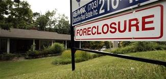 <p>A foreclosure sale sign sits in front of a house in Falls Church, Virginia, just outside Washington D.C. July 23, 2008. REUTERS/Kevin Lamarque</p>
