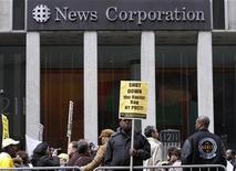 <p>Protesters march outside the News Corp. headquarters in New York in this file photo from February 19, 2009.REUTERS/Brendan McDermid</p>