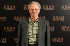 """<p>Director and actor Clint Eastwood poses during a photocall to promote his movie """"Gran Torino"""" in Paris February 24, 2009. REUTERS/Benoit Tessier</p>"""