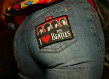 <p>Michele Bessem from Holland wears a Beatles patch as she queues at the Royal Albert Hall in London for the George Harrison memorial concert, November 29, 2002. REUTERS/Peter Macdiarmid</p>
