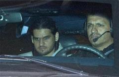 <p>Momin Khawaja (L) is transported from the Ottawa courthouse following a day of hearings, July 22, 2008. REUTERS/Chris Wattie</p>