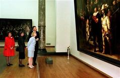 "<p>Then-U.S. First Lady Hillary Clinton (R), wife of the Dutch Prime Minister Rita Kok (C) and Dutch Princess Margriet (L) listen to the explanations of a guide as they admire the ""Night Watch"" painted by Dutch master Rembrandt van Rijn at the Rijksmuseum in Amsterdam, in this file photo from May 27, 1997.</p>"