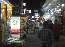 <p>People walk down Soi Arab street in Bangkok's North Nana neighbourhood, March 8, 2009. REUTERS/Chawadee Nualkhair</p>