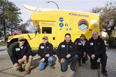 <p>Members of an expedition into Canada's north pose with their vehicle in Vancouver, British Columbia March 13, 2009. Team members are (L to R) Jesse Weaver, John Schutt, Dr. Pascal Lee, Kira Lorber and Dr. Stephen Braham. The scientists, who normally study the exploration of Mars, are planning the first ever land vehicle crossing of the fabled Northwest Passage. REUTERS/Andy Clark</p>