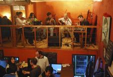 """<p>The band """"Dublingers"""" performs at a pub in Beijing in this February 3, 2009 handout photo. REUTERS/Handout</p>"""