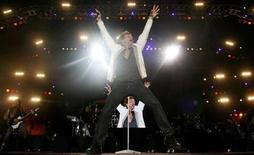 """<p>Jon Bon Jovi of the U.S. rock band Bon Jovi performs during the """"Rock in Rio"""" music festival in Lisbon May 31, 2008. REUTERS/Nacho Doce</p>"""