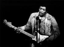 <p>A file photo shows Jimi Hendrix performing at the Gillmore East. REUTERS/AMALIE R./Handout</p>