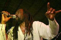 <p>South African reggae star Lucky Dube performs at a concert in Lagos, Nigeria, in this October 16, 2006 file picture. Three men accused of murdering South African reggae star Lucky Dube in 2007 have been found guilty, Talk Radio 702 reported on Tuesday. REUTERS/Akintunde Akinleye/Files</p>