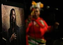 <p>A poster of the late South African reggae star Lucky Dube is seen as his band members perform during his memorial service in Johannesburg October 24, 2007. REUTERS/Siphiwe Sibeko</p>