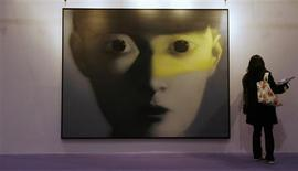 <p>An untitled contemporary Chinese painting by Zhang Xiaogang is displayed at Sotheby's auction house preview ahead of its Spring Sales in Hong Kong April 2, 2009. REUTERS/Bobby Yip</p>