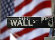 <p>The Wall Street sign is seen outside the New York Stock Exchange, March 26, 2009. REUTERS/Chip East</p>