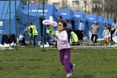<p>A child smiles as she runs in a tent camp where earthquake victims reside in Aquila April 7, 2009. REUTERS/Alessandro Garofalo</p>