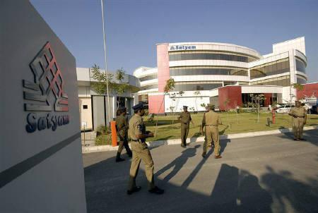 Policemen walk inside the Satyam Computer Services head office in Hyderabad in this January 2009 file photo. Company Law Board (CLB) on Thursday approved the takeover of fraud-hit Satyam Computer Services Ltd by mid-sized outsourcer Tech Mahindra Ltd, as had been expected.  REUTERS/Krishnendu Halder