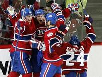 <p>Montreal Canadiens' Saku Koivu (2nd left) celebrates his winning goal against Tampa Bay Lightning with teammates during overtime NHL hockey action in Montreal, March 26, 2009. REUTERS/Christinne Muschi</p>