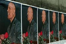 <p>Posters bearing the profile of Fascist dictator Benito Mussolini are plastered on walls in central Rome April 28, 2002. REUTERS/Vincenzo Pinto</p>